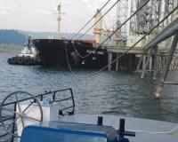 Triumph V releasing from loaded grain ship
